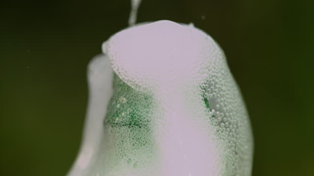 slomo soda bubbles up out of plastic bottle - human finger stock videos & royalty-free footage