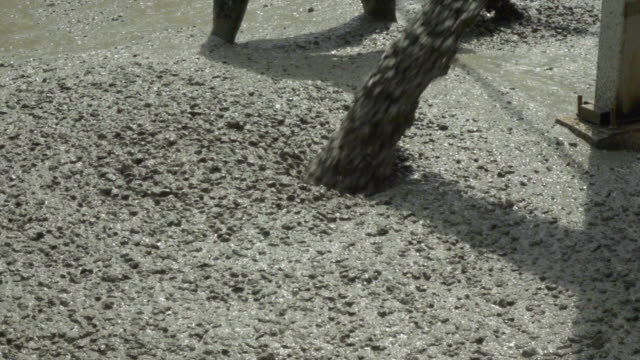 slomo spreading cement. - concrete stock videos & royalty-free footage