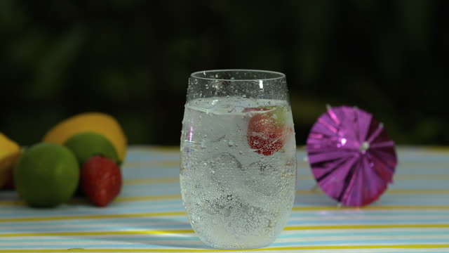 slomo strawberries fall into drink - 40 seconds or greater stock videos & royalty-free footage