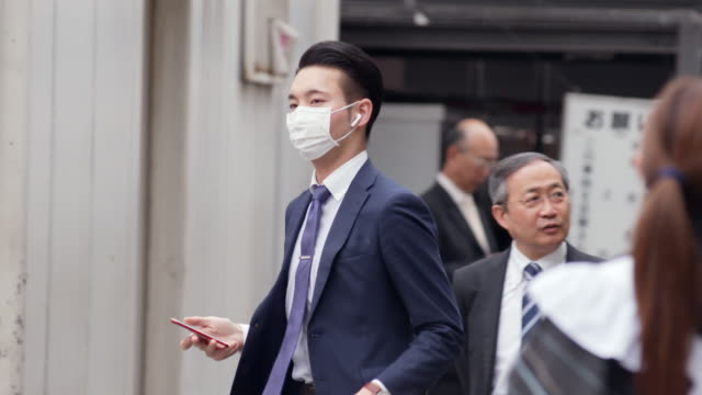 slomo young men wearing suits in tokyo - full suit stock videos & royalty-free footage