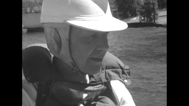 vídeos y material grabado en eventos de stock de slomoshun iv at dock on lake washington / owner and pilot stanley s sayres in helmet and life preserver / sayres sits in boat with infant next to him... - hidroplano