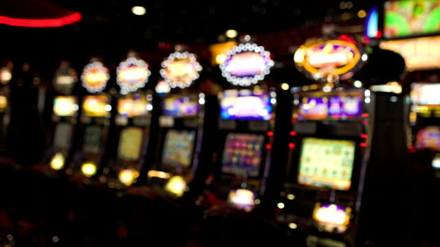 stockvideo's en b-roll-footage met hd: slot machines in casino, defocused - casino