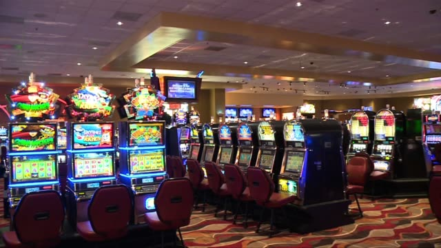 slot machines inside casino - casino winner stock videos & royalty-free footage