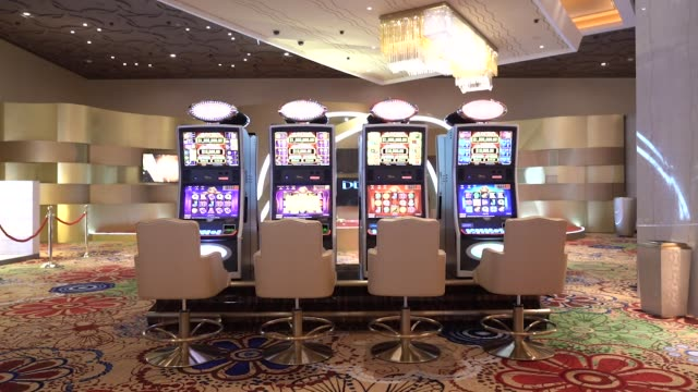 slot machines stand on the gaming floor of the casino at the mgm cotai casino resort developed by mgm china holdings ltd in macau china on tuesday... - casino floor stock videos & royalty-free footage