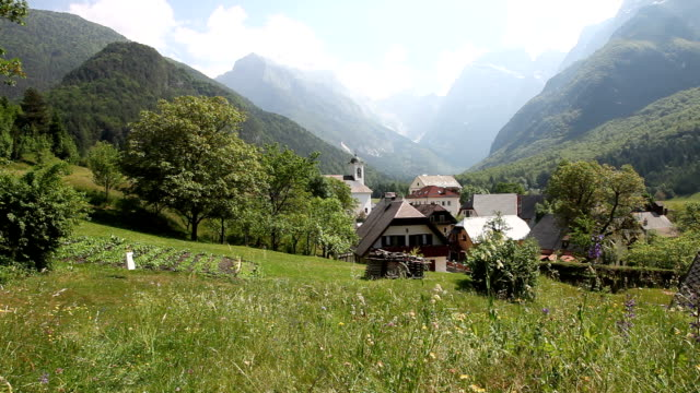 slovenia, bovec, log pod magartom, view of the village - slovenia meadow stock videos & royalty-free footage
