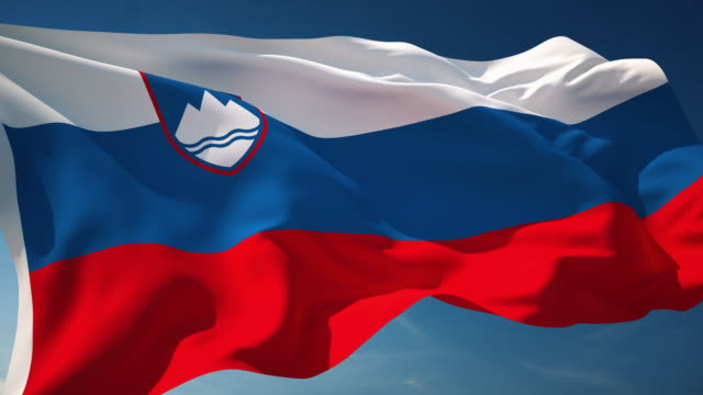 4k slovenia flag - loopable - slovenia stock videos & royalty-free footage