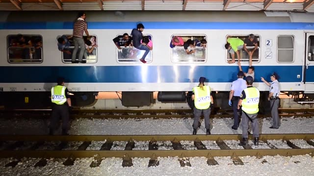 slovenian police stop a train carrying migrants and refugees at the border with croatia saying some 150 passengers would be returned to zagreb... - zagreb stock videos and b-roll footage
