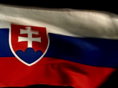 slovenska republika country flag flying against black bg three horizontal bands white blue red w/ coat of arms positioned closer to hoist side - slovakia stock videos & royalty-free footage