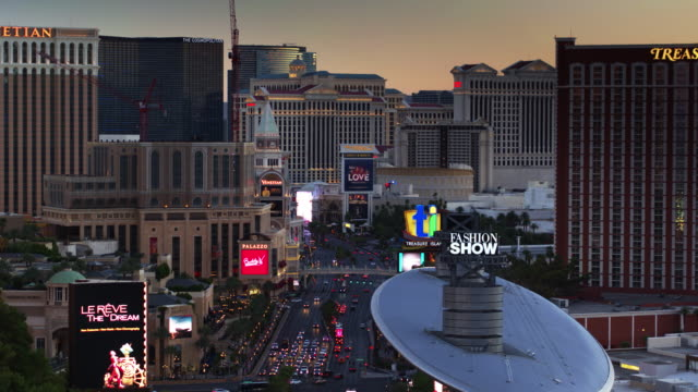 slow ascent over the las vegas strip at sunset - drone shot - las vegas stock-videos und b-roll-filmmaterial