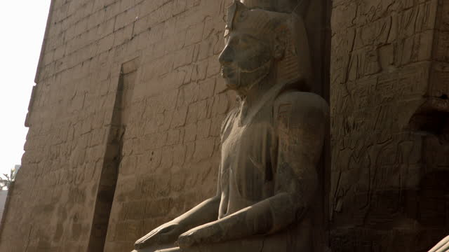 slow crane up statue of ramses ii, egypt - stone material stock videos & royalty-free footage