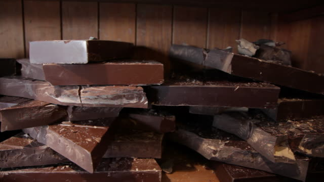 slow dolly move across slabs of chocolate in bruges, belgium - block shape stock videos & royalty-free footage
