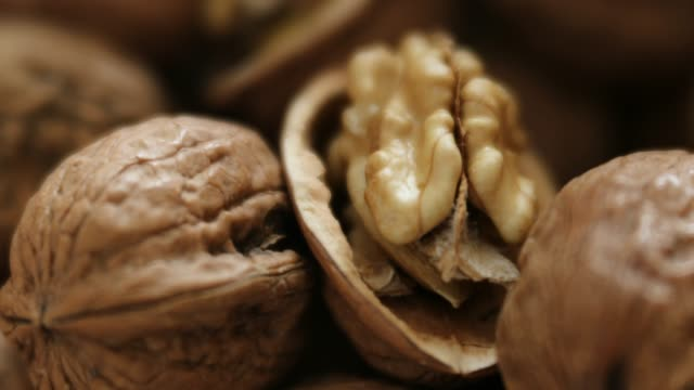 slow dolly move across walnuts - nutshell stock videos & royalty-free footage