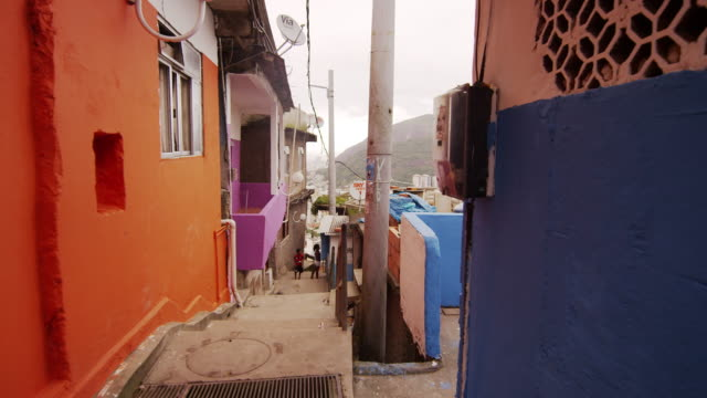 RIO DE JANEIRO, BRAZIL - JUNE 23: Slow dolly shot of favela alley on June 23, 2013 in Rio, Brazil