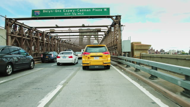 slow drive across the brooklyn bridge - taxi stock videos & royalty-free footage