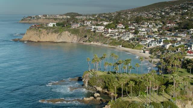 slow drone flight over orange county coast at laguna beach - laguna beach california stock videos & royalty-free footage