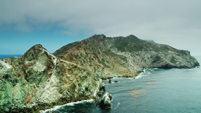 slow drone flight past stony western coast of catalina island - channel islands california stock videos & royalty-free footage