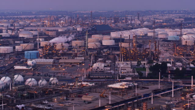 slow flight across massive oil refinery complex - port of los angeles stock videos & royalty-free footage