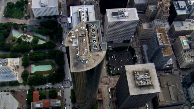 slow flight with steep view down above buildings of downtown houston; links to solo clip t523-16. shot in 2007. - artbeats stock videos & royalty-free footage