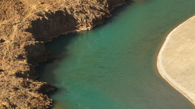 a slow flowing indus river  with an eroded bank, northern india - other stock videos and b-roll footage