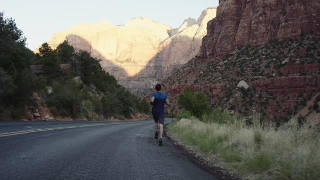 4K Slow Mo: Athletic Man Jogging through Zion