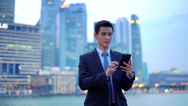 ms slow mo ts businessman working on his phone in the city - asia stock videos & royalty-free footage