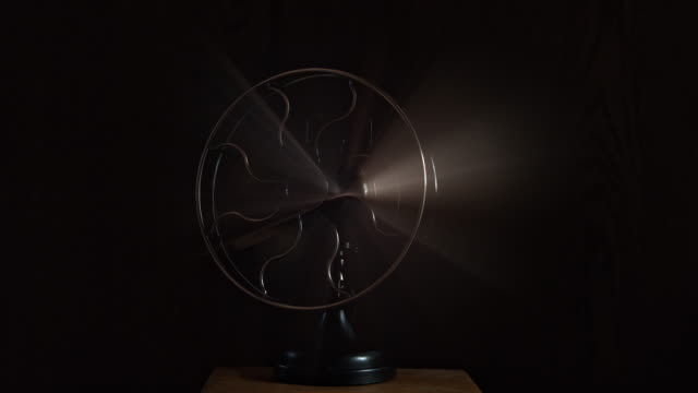 slow mo medium schot of an old rotating fan - ventilator stock-videos und b-roll-filmmaterial