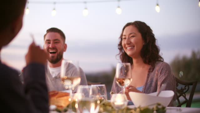 slow mo cu people laughing at a dinner party - elegance stock videos & royalty-free footage