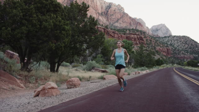 4k slow mo: young woman running through zion - zion national park stock videos and b-roll footage