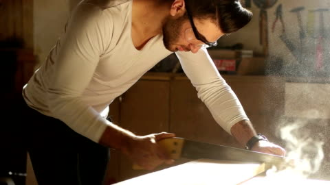 slow mot- carpenter at work - sander stock videos & royalty-free footage