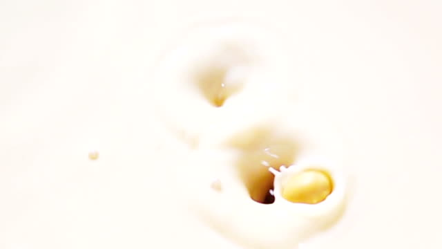 slow motion , 1000 fps : soy bean falling into milk - soy milk stock videos and b-roll footage