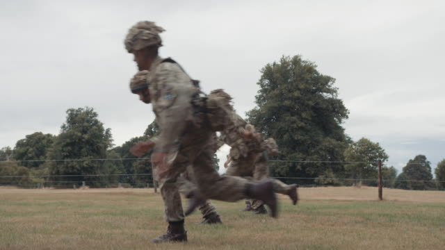 slow motion 1080p stock footage of nepalese gurkha soldiers of the british army training on an obstacle course - infantry stock videos & royalty-free footage