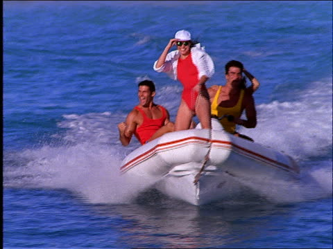 slow motion 2 couples riding speedboat on ocean toward camera / cancun - speed boat stock videos & royalty-free footage