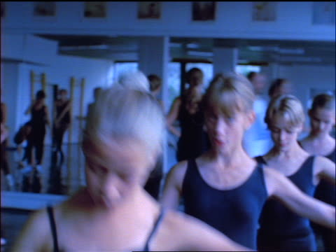blue slow motion pan 4 young girls in ballet class practicing at barre / czech republic - barre stock videos & royalty-free footage