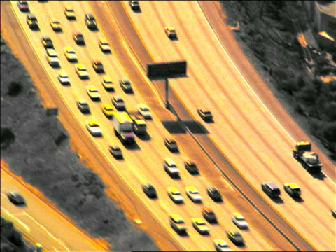 sepia slow motion aerial over traffic jam on highway / southern california - viraggio video stock e b–roll