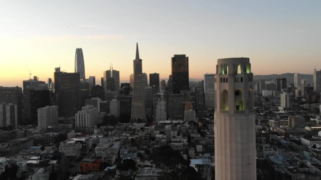 slow motion aerial video - coit tower in san francisco - capital cities stock videos & royalty-free footage