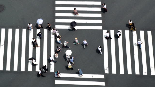 slow motion - aerial view of a crossing in ginza - crossroad stock videos & royalty-free footage