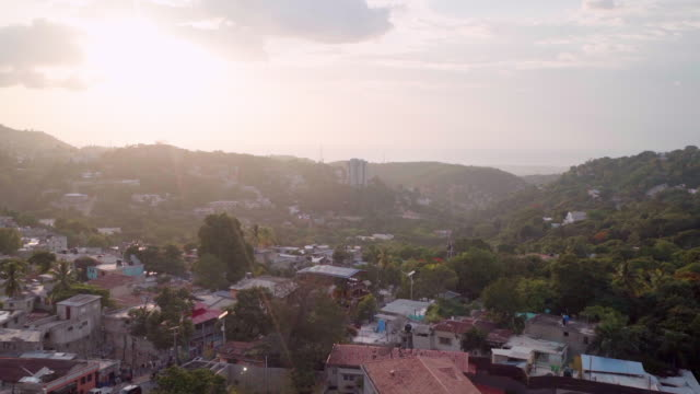 slow motion aerial view of carrefour town in haiti at sunset - haiti stock videos & royalty-free footage