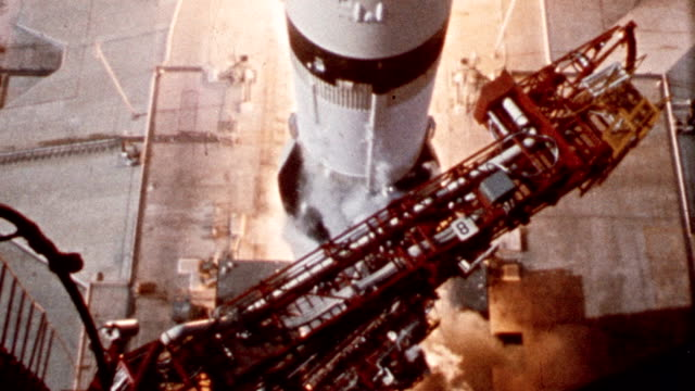 Slow motion Apollo 11 rocket blasting off from launch pad