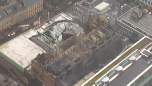 slow motion ariel shot of the collapsed rooftop of the glasgow school of art - charles rennie mackintosh stock videos and b-roll footage