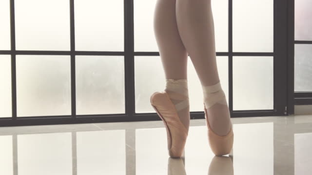 slow motion asia graceful young girl practicing ballet dancing ballerina spinning + jumping in studio classroom - toe stock videos & royalty-free footage