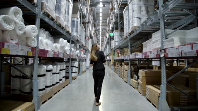 Slow motion Asian Female factory worker Checking stock in the factory.