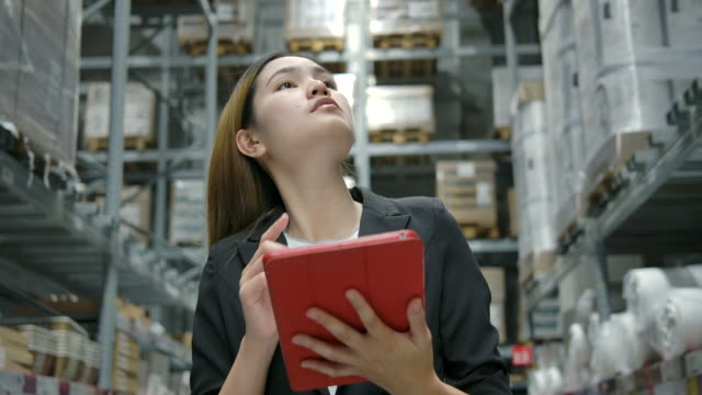 slow motion asian female factory worker checking stock in the factory. - efficiency stock videos & royalty-free footage