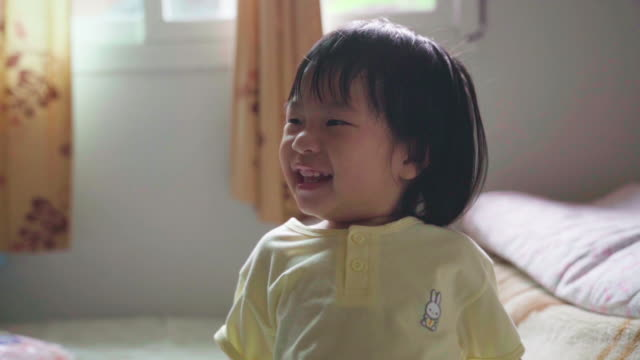 slow motion asian girl is smile and happiness - brown stock videos & royalty-free footage