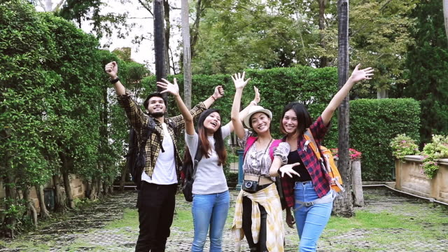Slow motion Asian Group of young people with friends backpacks walking and hiking together and happy friends are taking photo and selfie ,Relax time on holiday concept travel