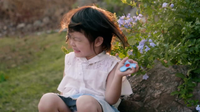slow motion : asian little girl tossing hair - thick stock videos & royalty-free footage