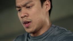 Slow Motion : Asian man running on treadmill