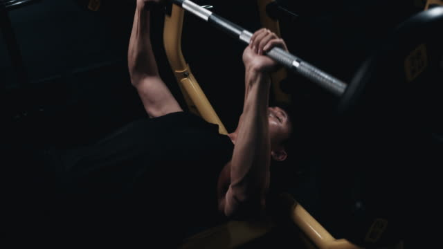 4k slow motion asian men exercising in the gym, weightlifting strong man doing barbell, in the hardcore gym. muscular and athletic bodybuilder - only men stock videos & royalty-free footage