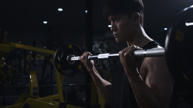 4k slow motion asian men exercising in the gym, weightlifting strong man doing barbell, in the hardcore gym. muscular and athletic bodybuilder - weight training stock videos & royalty-free footage