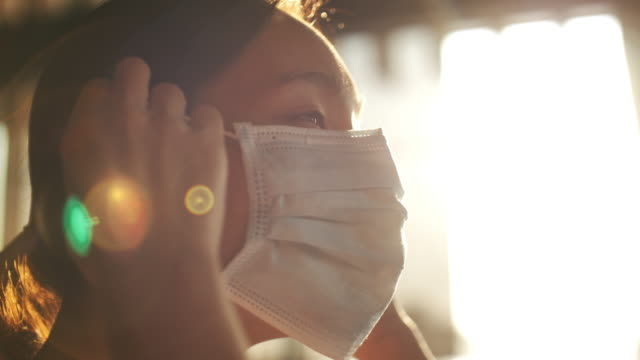 slow motion asian woman wearing a protective face mask - respiratory system stock videos & royalty-free footage