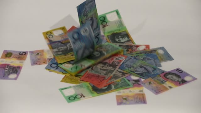 Slow Motion Australian dollar banknotes of various denominations are dropped into a pile in an arranged video in Sydney Australia on Friday Aug 4 2017